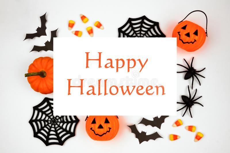 Happy Halloween greeting on a white background with frame of decor royalty free stock photo