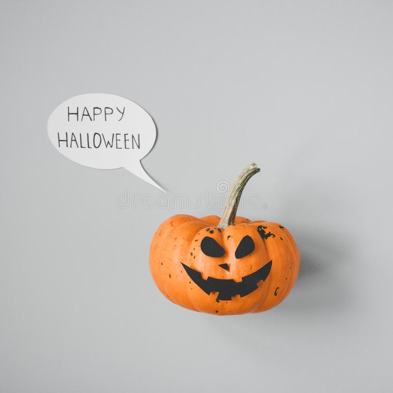 Happy halloween. Halloween pumpkin Jack o Lantern on gray background.  stock photo