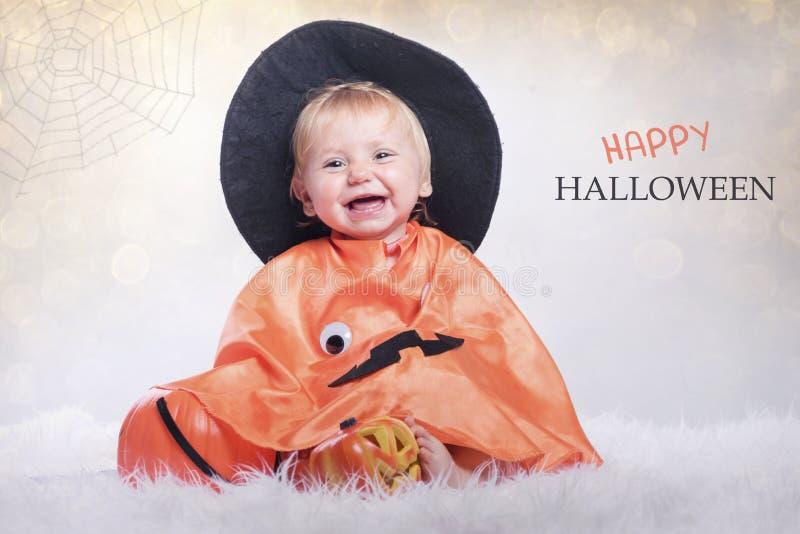 Happy halloween. Baby disguised in halloween stock images