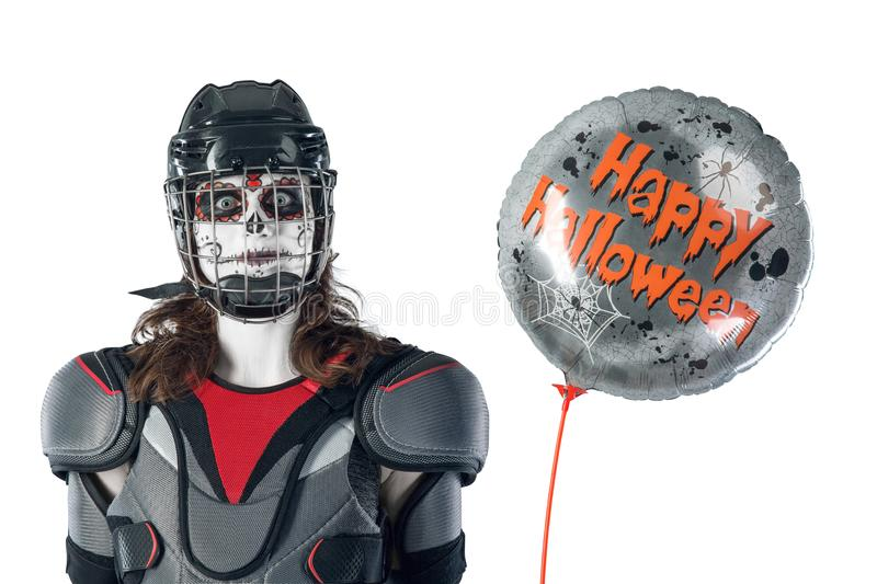 Happy halloween. hockey player in a hockey helmet and mask with a balloon against isolated backdrop or background. All Saints` Da. Happy halloween. hockey player stock photography