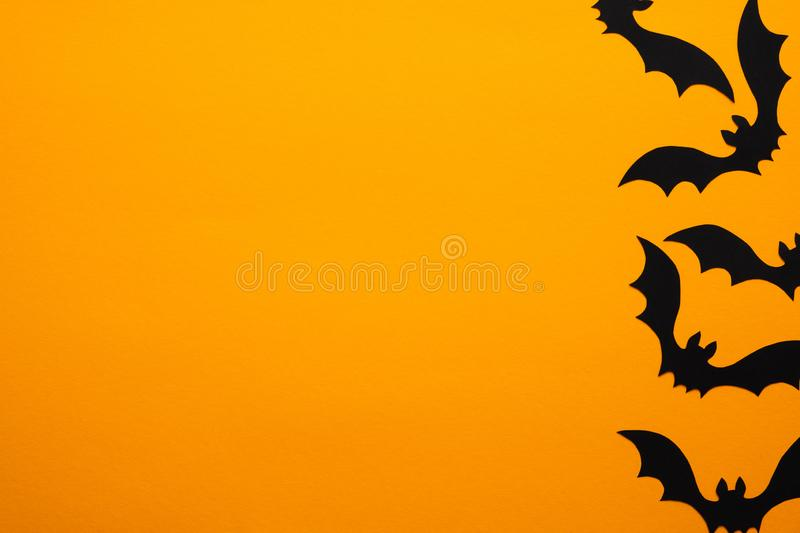 Happy halloween holiday concept. Halloween bats on orange background. Halloween party greeting card mockup with copy space. Flat. Lay, top view, overhead royalty free stock photography