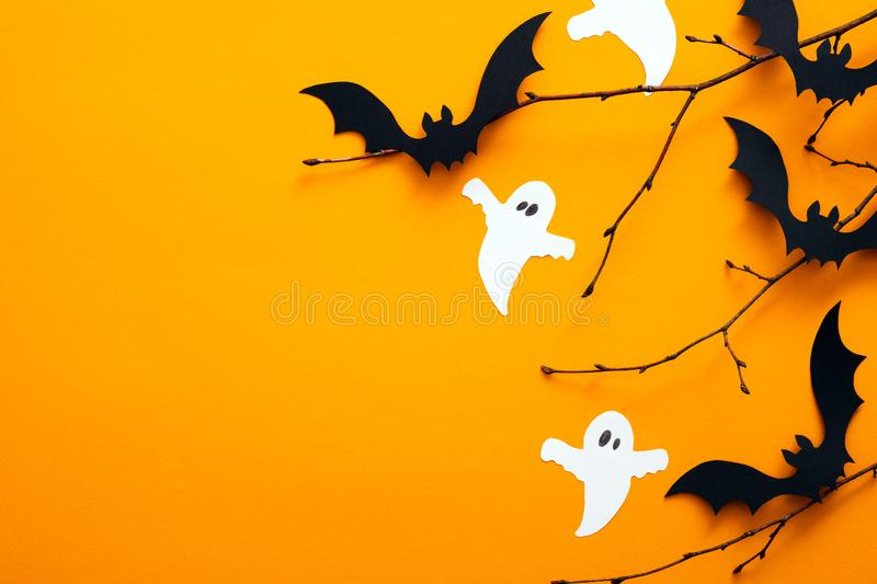 Happy halloween holiday concept. Halloween decorations, bats, ghosts on orange background. Halloween party greeting card mockup. With copy space. Flat lay, top royalty free stock photos