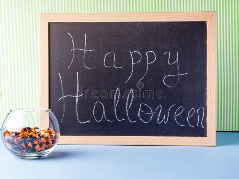 Happy Halloween. Holiday greetings on blackboard. Happy Halloween. Holiday greetings written with chalk on blackboard stock images