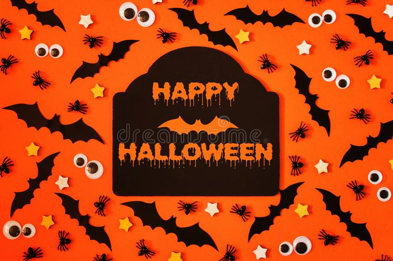 Happy Halloween, inscription in the center. Around decorative bats, asterisks and puppet eyes. Terrible picture for the holiday royalty free stock photos
