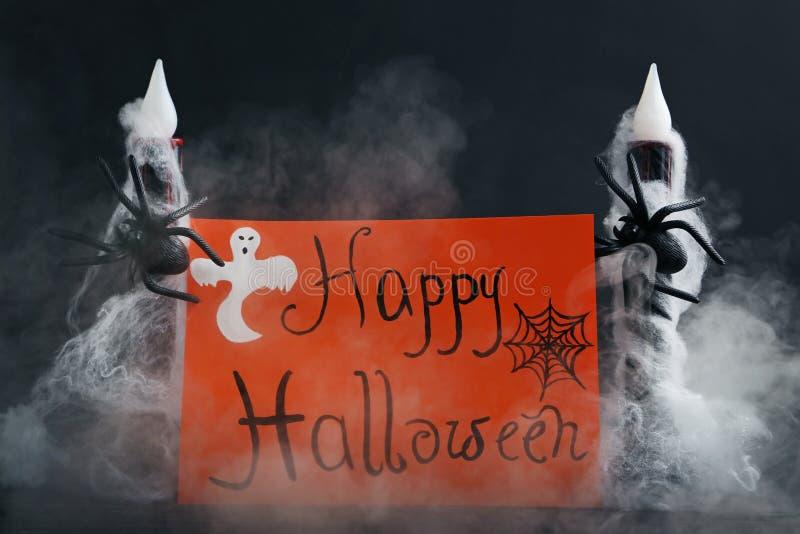 Happy Halloween. Inscription Happy Halloween on orange paper with spiders royalty free stock photos