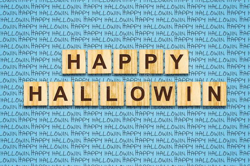 Happy halloween lettering on wooden blocks on a blue background. Festive background. Holidays. Backgrounds stock photo