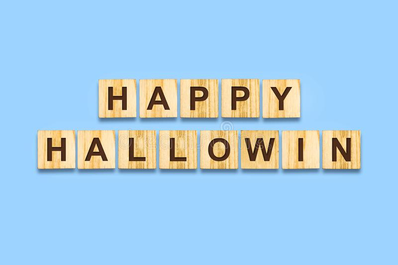 Happy Halloween lettering on wooden blocks on a blue background.Isolated Festive background. Holidays. Backgrounds stock photos