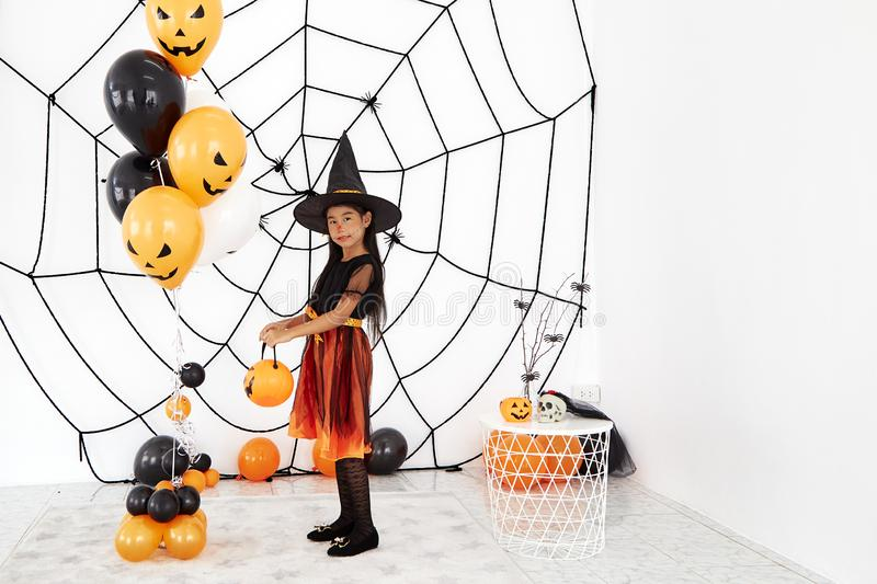 Happy Halloween little witch with a pumpkin royalty free stock images