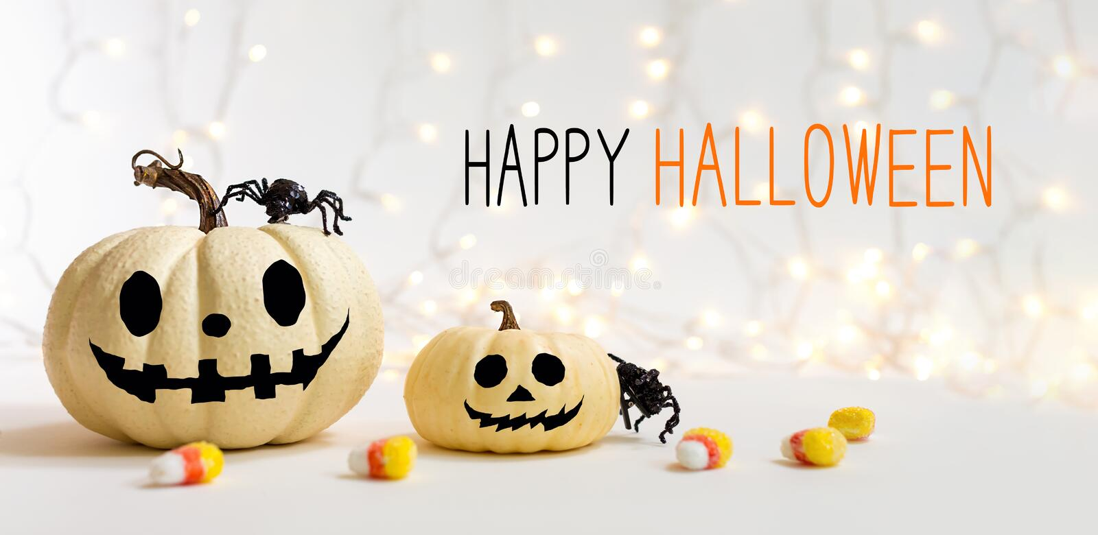 Happy Halloween message with pumpkins with spider. On a shiny light background royalty free stock photos