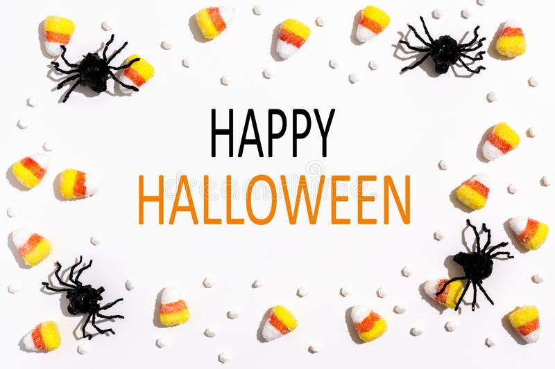 Happy Halloween message with spiders overhead view stock images