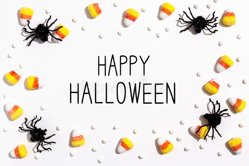 Happy Halloween message with spiders overhead view stock photography
