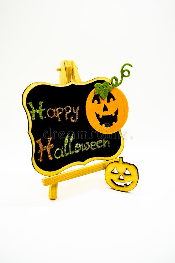 Happy Halloween message write on a blackboard with pumpkins. Isolated on white background. Autumn orange pumpkin celebration. All Hallows` Even. Jack-o` stock images
