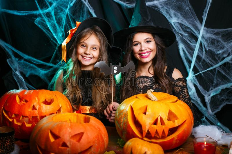 Happy Halloween. Mother and her daughter in witch costumes having fun at home. Mother and her daughter in witch costumes having fun at home. Happy Family stock image