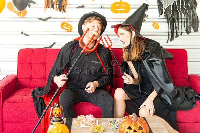 Happy Halloween party concept. Young man and woman wearing as vampires, witch or ghost celebrate the halloween festival. Happy Halloween party concept. Young men royalty free stock photos