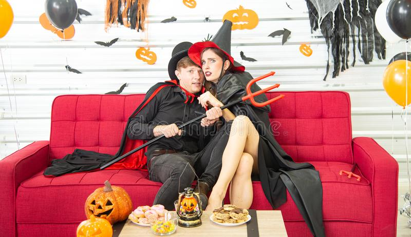 Happy Halloween party concept. Young man and woman wearing as vampires, witch or ghost celebrate the halloween festival. Happy Halloween party concept. Young men stock photos