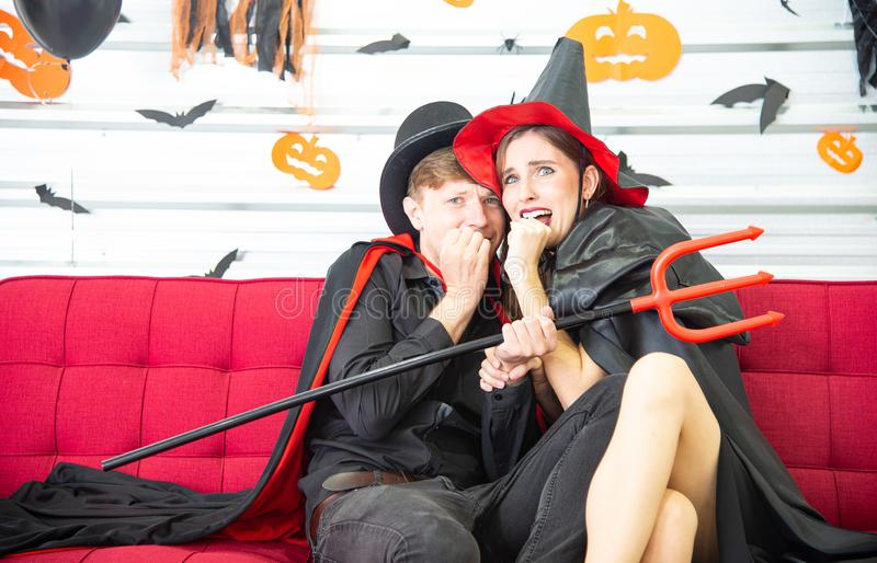 Happy Halloween party concept. Young man and woman wearing as vampires, witch or ghost celebrate the halloween festival. Happy Halloween party concept. Young men royalty free stock photography