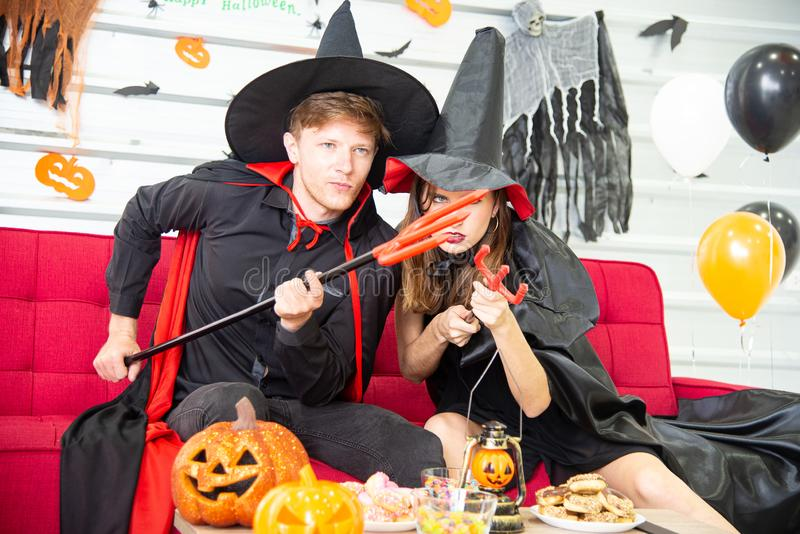 Happy Halloween party concept. Young man and woman wearing as vampires, witch or ghost celebrate the halloween festival. Happy Halloween party concept. Young men royalty free stock photo