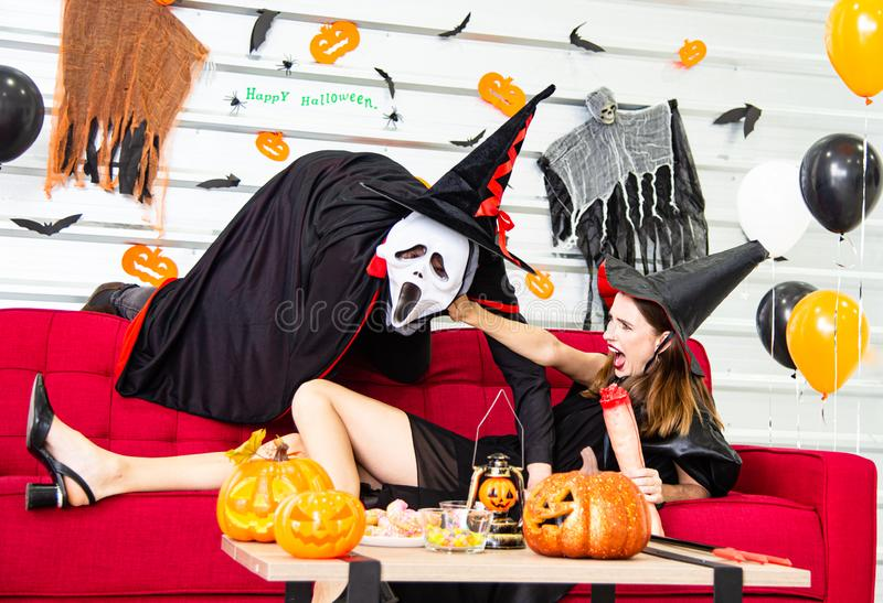 Happy Halloween party concept. Young man and woman wearing as vampires, witch or ghost celebrate the halloween festival. Happy Halloween party concept. Young men royalty free stock image