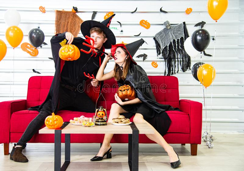 Happy Halloween party concept. Young man and woman wearing as vampires, witch or ghost celebrate the halloween festival. Happy Halloween party concept. Young men royalty free stock images