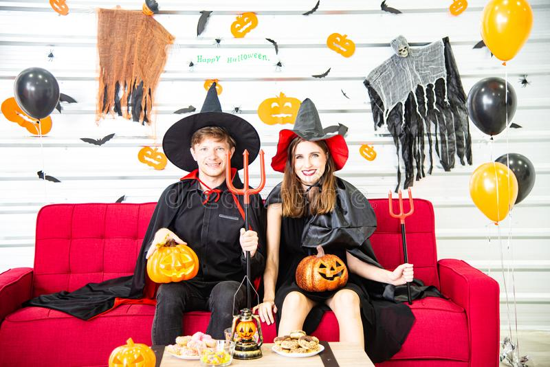 Happy Halloween party concept. Young man and woman wearing as vampires, witch or ghost celebrate the halloween festival. Happy Halloween party concept. Young men stock image