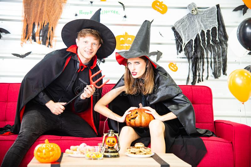 Happy Halloween party concept. Young man and woman wearing as vampires, witch or ghost celebrate the halloween festival. Happy Halloween party concept. Young men stock photography