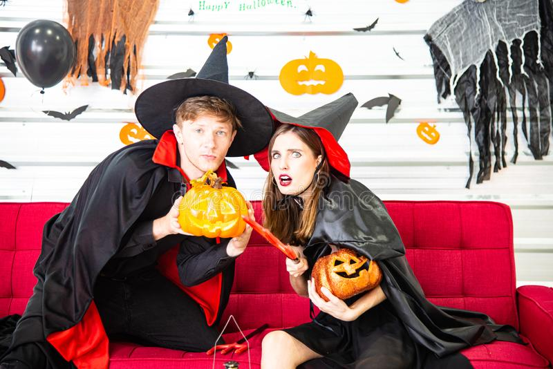 Happy Halloween party concept. Young man and woman wearing as vampires, witch or ghost celebrate the halloween festival. Happy Halloween party concept. Young men stock photo