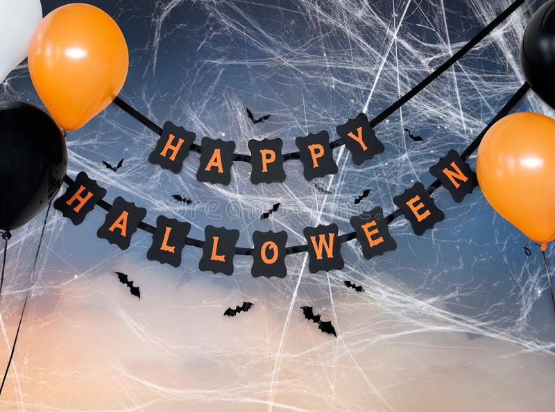 Happy halloween party garland with air balloons. Holidays, decoration and party concept - happy halloween festive paper black garland or banner with air balloons royalty free stock images