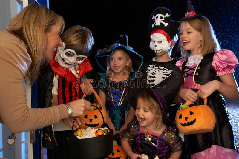 Happy Halloween party trick or treating. Happy Halloween party with children trick or treating royalty free stock photography