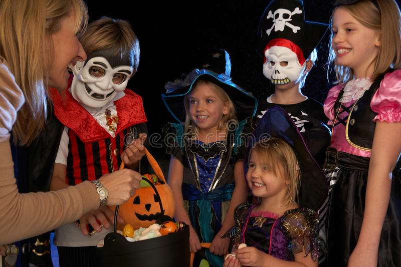 Happy Halloween party trick or treating. Happy Halloween party with children trick or treating stock photography