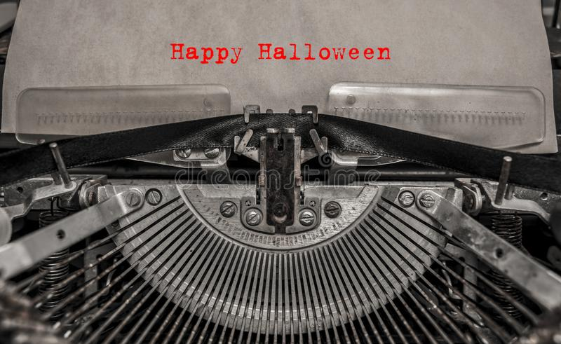 Happy Halloween printed on a vintage typewriter. Old typewriter with text red happy halloween stock image