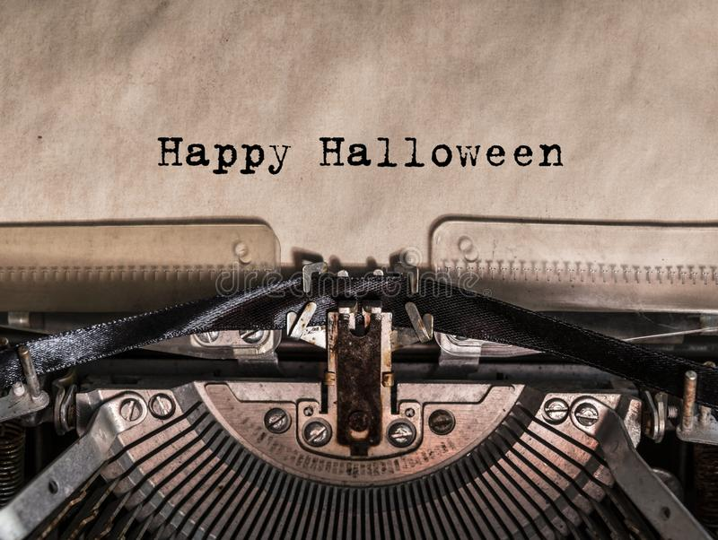 Happy Halloween printed on a vintage typewriter. Old typewriter with text happy halloween royalty free stock photo