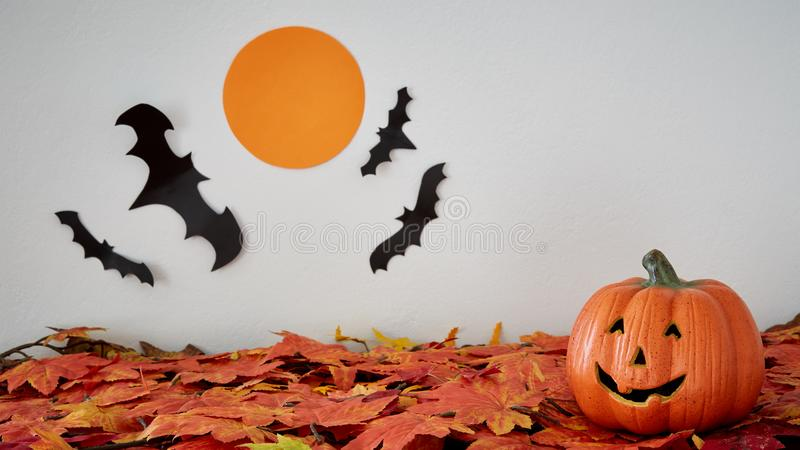 Happy Halloween pumpkin head jack lantern with bat and moon on l stock photos