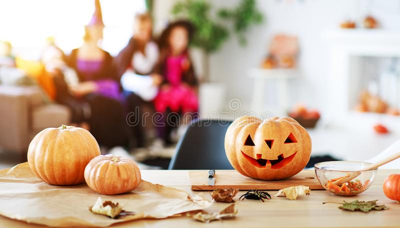Happy Halloween! pumpkin Jack lantern with carved smile for family holiday at  home royalty free stock photography