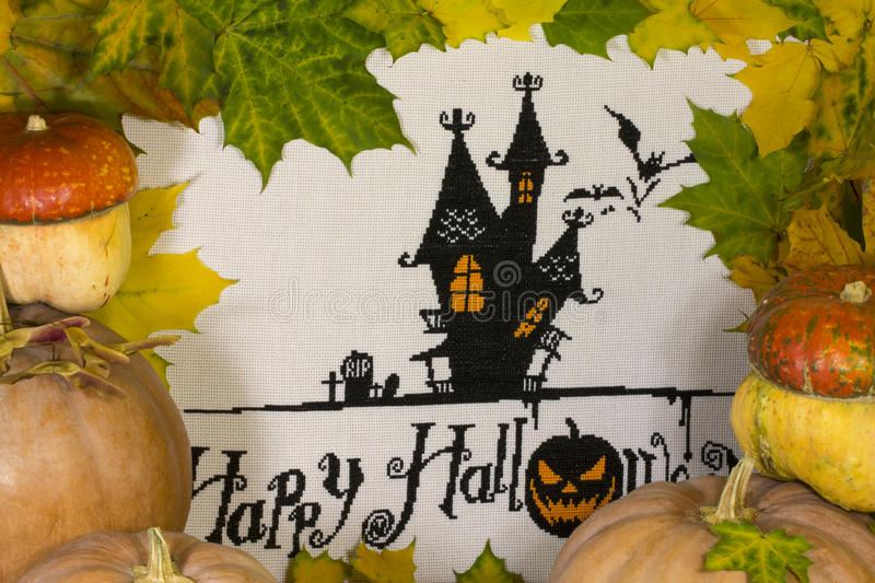 Happy Halloween. With pumpkins of different varieties on the background of maple leaves royalty free stock photography