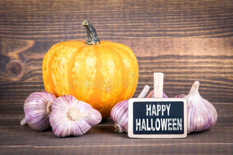Happy Halloween, pumpkins and garlic royalty free stock photos