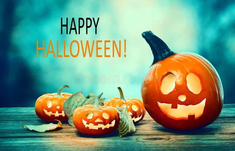 Happy Halloween with pumpkins at night. Happy Halloween with pumpkins on a spooky forest at night stock photos