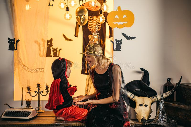 31 october. Magic hat. Best ideas for Halloween. Mother and child boy playing together. Mother wearing as witch, son. Happy Halloween Quotes and Sayings. Happy royalty free stock image