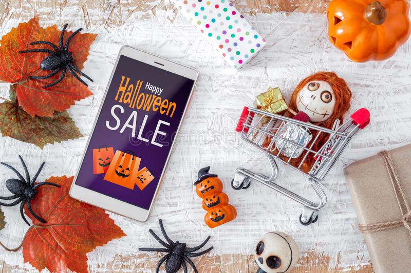 Happy Halloween Sale shopping online  promotion offer background concept, smartphone mockup banner flat lay design stock photos