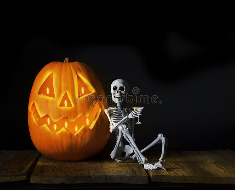 Happy Halloween Skeleton Drinking Martini stock images