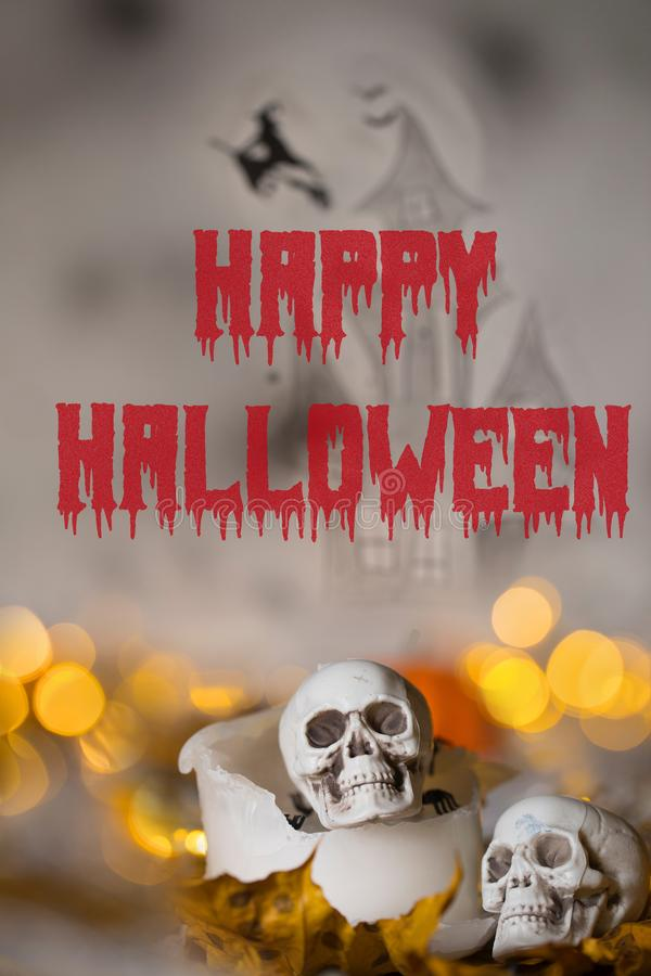 Happy Halloween. Skull on an old used thick candle. Scary Hallow royalty free stock photography