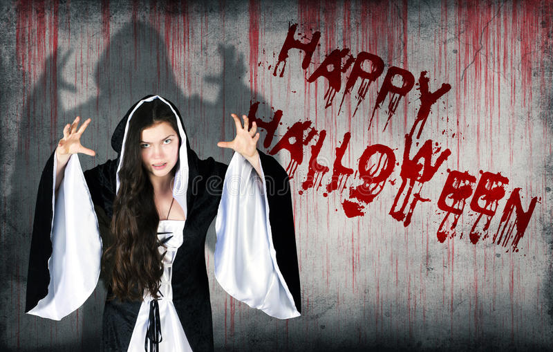 Happy Halloween sprayed on wall next to a witch royalty free stock photo
