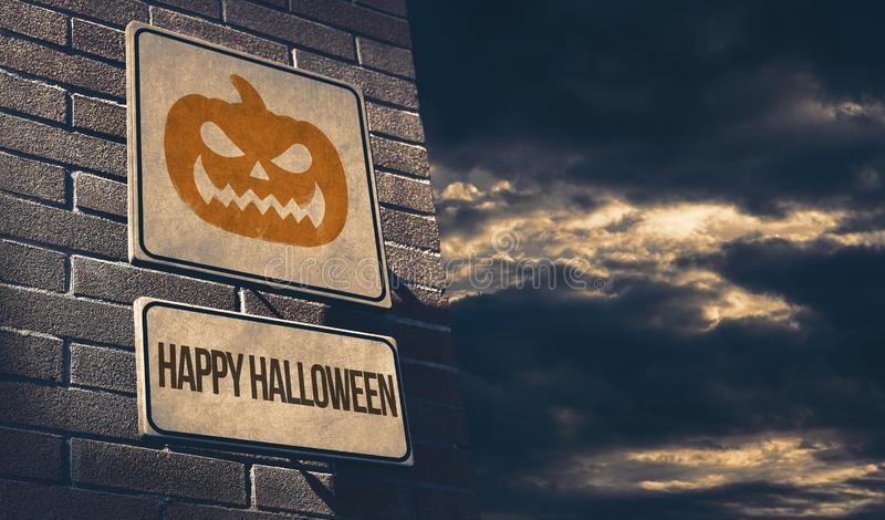 Happy halloween street sign with scary pumpkin royalty free stock images