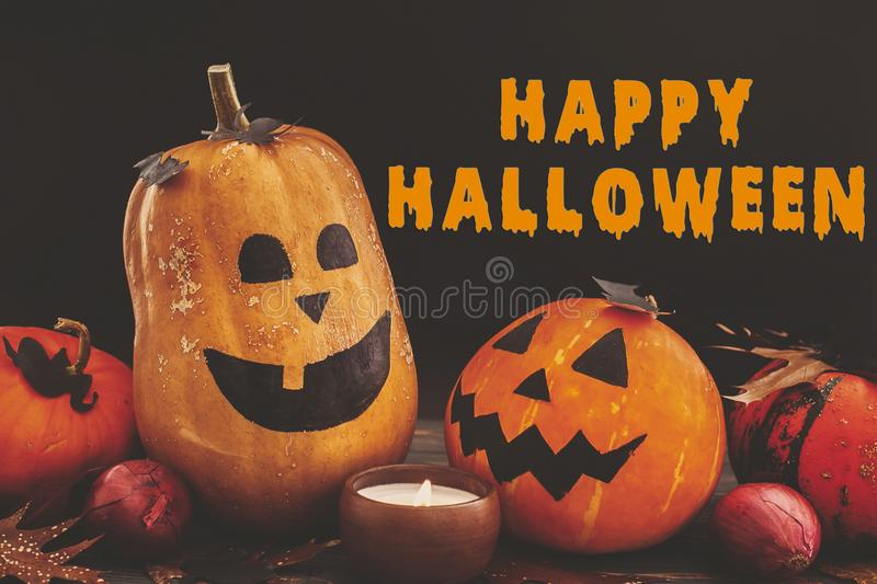 Happy Halloween text, bloody sign on pumpkins, jack-o-lantern, w stock images