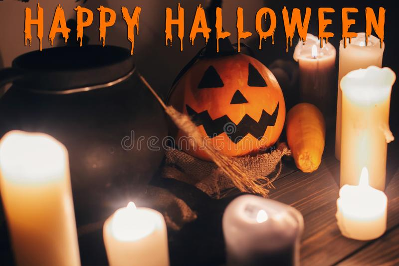 Happy Halloween text concept. Seasons greeting, spooky Halloween. Sign. Witch cauldron, Jack o lantern, pumpkin,candles, broom and bats, ghosts in night stock photography