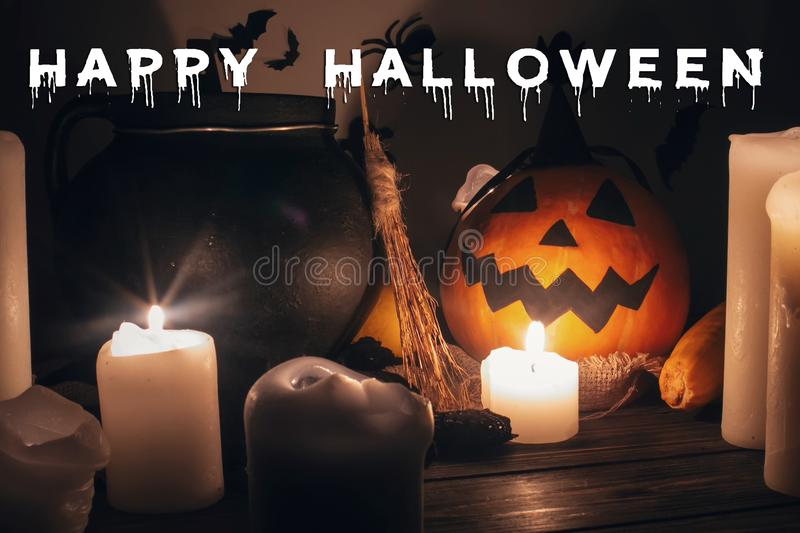 Happy Halloween text concept. Seasons greeting, spooky Halloween. Sign. Jack o lantern, Witch cauldron, pumpkin,candles, broom and bats, ghosts in night royalty free stock photography