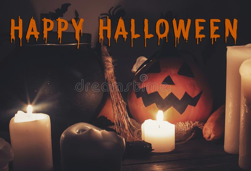 Happy Halloween text concept. Seasons greeting, spooky Halloween. Sign. Witch cauldron, Jack o lantern, pumpkin,candles, broom and bats, ghosts in night royalty free stock photos