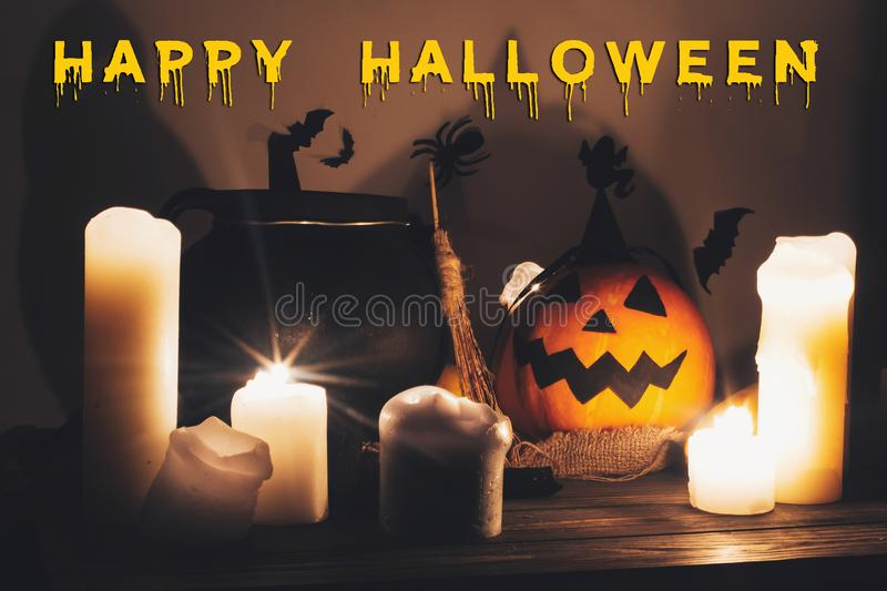 Happy Halloween text concept. Seasons greeting, spooky Halloween. Sign. Jack o lantern, Witch cauldron, pumpkin,candles, broom and bats, ghosts in night royalty free stock photos