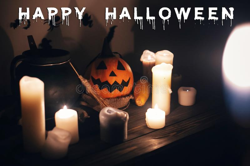 Happy Halloween text concept. Seasons greeting, spooky Halloween. Sign. Jack o lantern, Witch cauldron, pumpkin,candles, broom and bats, ghosts in night stock photos