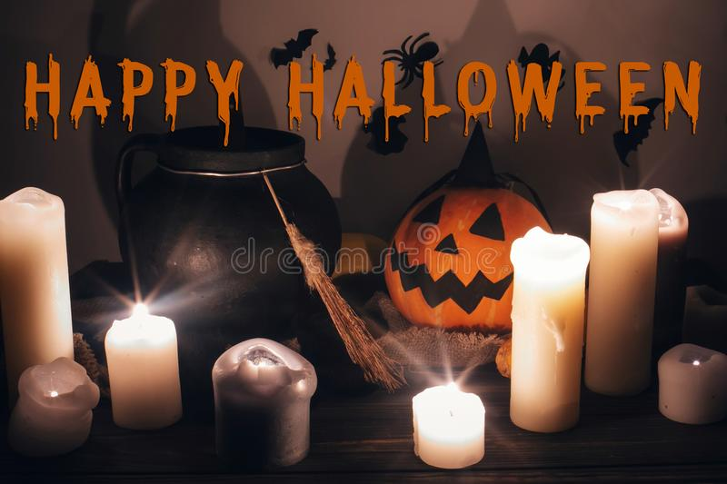 Happy Halloween text concept. Seasons greeting, spooky Halloween. Sign. Jack o lantern, Witch cauldron, pumpkin,candles, broom and bats, ghosts in night royalty free stock images