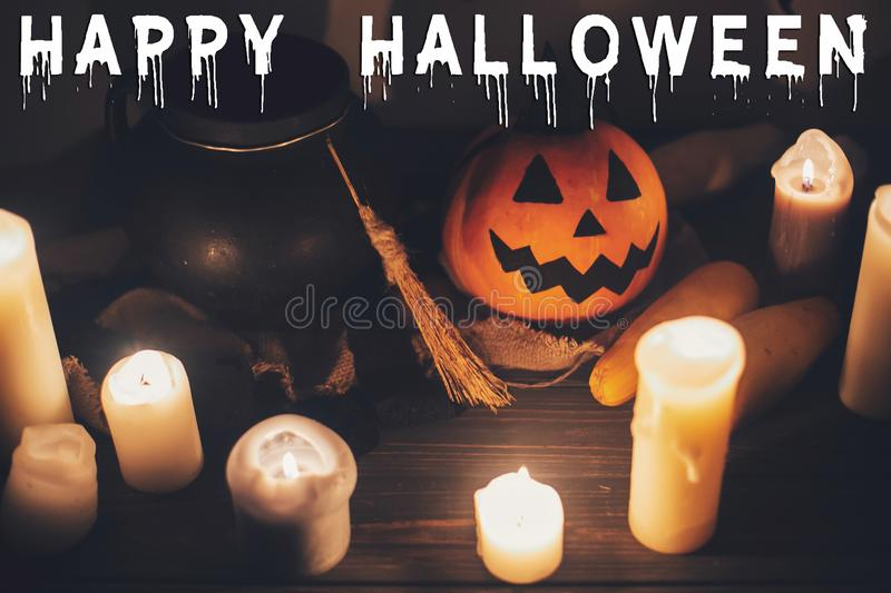 Happy Halloween text concept. Seasons greeting, spooky Halloween. Sign. Witch cauldron, Jack o lantern, pumpkin,candles, broom and bats, ghosts in night royalty free stock photography